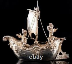 1900 Dutch silver miniature of two cherubs in a sailing boat, by Berthold Muller