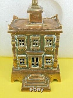 Cast Bronze /brass money box in the form of a bank with a spire