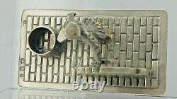 Dutch Solid silver miniature figure of a bricklayer building a wall hallmarked