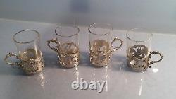 Four classical dutch silver glass holders with glasses with romance scenes