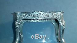 Silver miniature dutch silver suite of three chairs & table. Dolls house