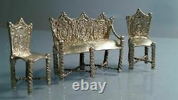 Silver miniature dutch suite of gothic style bench sofa & two chairs. Dolls