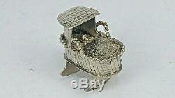 Solid silver miniature dutch toy baby in a rocking crib basket dolls house