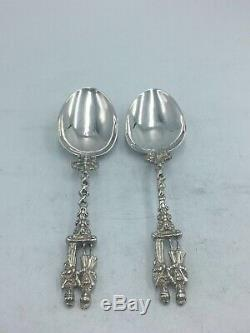 Two Pairs Of Dutch Solid Silver Serving Spoons